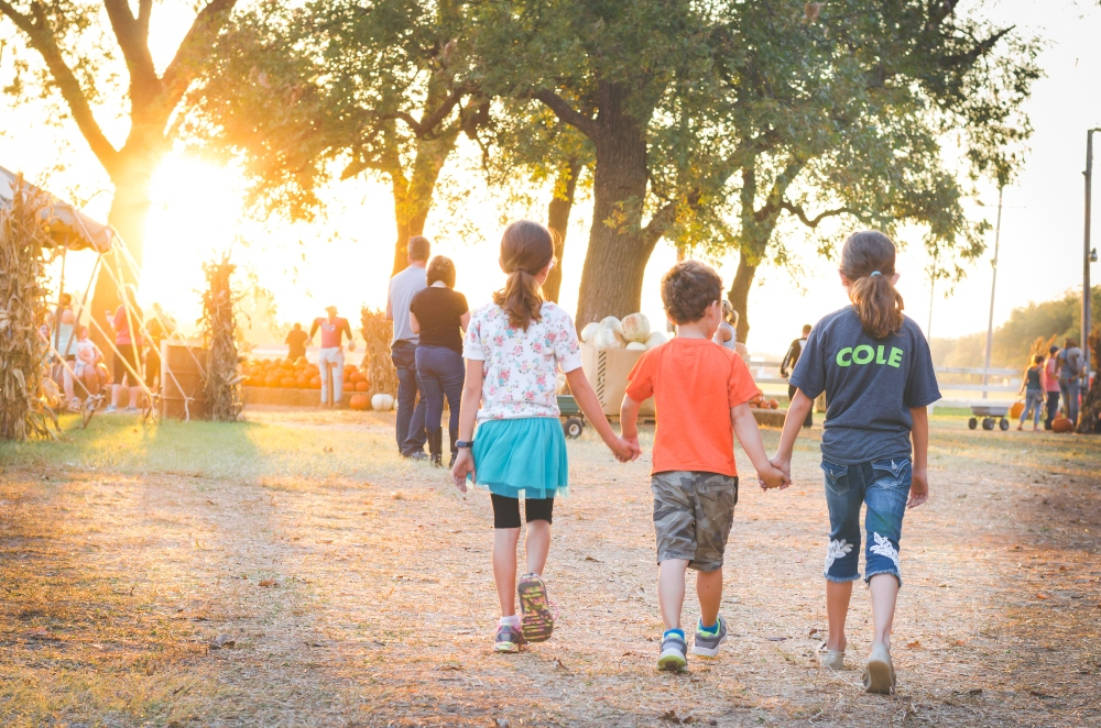 Family visiting fall festival in Branson MO